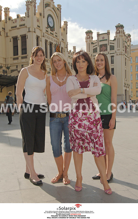 PICTURES FROM SOLARPIX.COM..Jacqueline Gold, owner of Ann summers at her store in Valencia with three employees during filming for the brand new LIvingTV show, Break With The Boss. They are pictured at the Valencia railway station. .L to r:.Andrea Mann, white top..Eve Tucker, pink top..Jacqueline Gold..Viv Benson, green top.DATE: 13/10/2006-JOB REF: 2920-ITS.