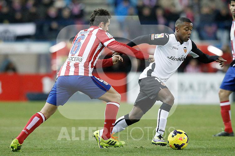 Atletico de Madrid's Koke (l) and Valencia's Dorlan Pabon during La Liga match.December 15,2013. (ALTERPHOTOS/Acero)