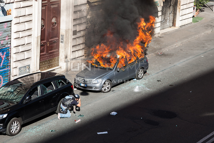A press photographer reporting during the manifestation of the Italian Indignados that turned into a violent guerrilla. Rome, Italy. Oct. 15, 2011. (Photo by Riccardo Budini / UnFrame)