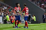 Atletico de Madrid's Thomas Teye (l) and Juanfran Torres during La Liga match. August 25, 2018. (ALTERPHOTOS/A. Perez Meca)