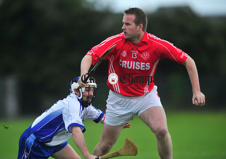 Eire Og's Barry Nugent escapes the tackle of Kilmaley's Sean Talty. Photograph by Declan Monaghan