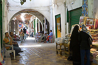 Tripoli, Libya - Street Scene, Covered Market, Women in Abayas on right,Tripoli Medina