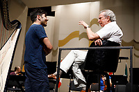 Valerio Lisci from Italy, left, speaks with conductor Arthur Fagen before an orchestra rehearsal for the Final Stage concert at the 11th USA International Harp Competition at Indiana University in Bloomington, Indiana on Friday, July 12, 2019. (Photo by James Brosher)
