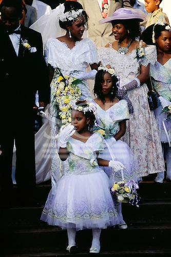 Dar-es-Salaam, Tanzania. Bride, groom and bridesmaid after the wedding ceremony.