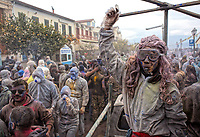 Pictured: Flour wars participants on a float in Galaxidi, Greece. Monday 19 February 2018<br /> Re: Clean Monday (Monday of Lent) celebration of flour wars (Alevromoutzouroma) in the town of Galaxidi, which coincides with the beginning of the Greek Orthodox Lent in Greece. The origins of the custom are unclear, however it appears in its current form since the mid-19th century.<br /> Locals and visitors of all ages gather to collect large quantities of flour which they throw to each other. Various types of coloring is added for effect while people paint their faces with charcoal.