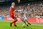 Lucas Vazquez of Real Madrid (R) fights for the ball with Simon Kjaer of Sevilla FC (L) during La Liga 2017-18 match between Real Madrid and Sevilla FC at Santiago Bernabeu Stadium on 09 December 2017 in Madrid, Spain. Photo by Diego Souto / Power Sport Images