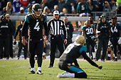 Referee John Hussey watches as Jacksonville Jaguars Josh Lambo (4) gets ready to kick an extra point during an NFL Wild-Card football game against the Buffalo Bills, Sunday, January 7, 2018, in Jacksonville, Fla.  (Mike Janes Photography)