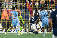 FOXBOROUGH, MA - SEPTEMBER 29: Teal Bunbury #10 of New England Revolution heads the ball into the goal during a game between New York City FC and New England Revolution at Gillettes Stadium on September 29, 2019 in Foxborough, Massachusetts.