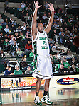 North Texas Mean Green guard Shannon Shorter (21) blocks a pass in the NCAA  basketball game between the Florida International University Panthers and the University of North Texas Mean Green at the North Texas Coliseum,the Super Pit, in Denton, Texas. UNT defeated FIU 87 to 77