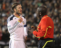 David Beckham (23) of the Los Angeles Galaxy talks to referee Abiodun Okulaja during an MLS match against D.C. United at RFK Stadium, on April 9 2011, in Washington D.C. The game ended in a 1-1 tie.