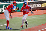 ABERDEEN, MD - AUGUST 02: Peter Vazquez #12 of Puerto Rico is congratulated by Coach Mahyko Torres #23 of Puerto Rico after hitting his second home run of the game between the Dominican Republic and Puerto Rico during the Cal Ripken World Series at The Ripken Experience Powered by Under Armour on August 2, 2016 in Aberdeen, Maryland. (Photo by Ripken Baseball/Eclipse Sportswire/Getty Images)
