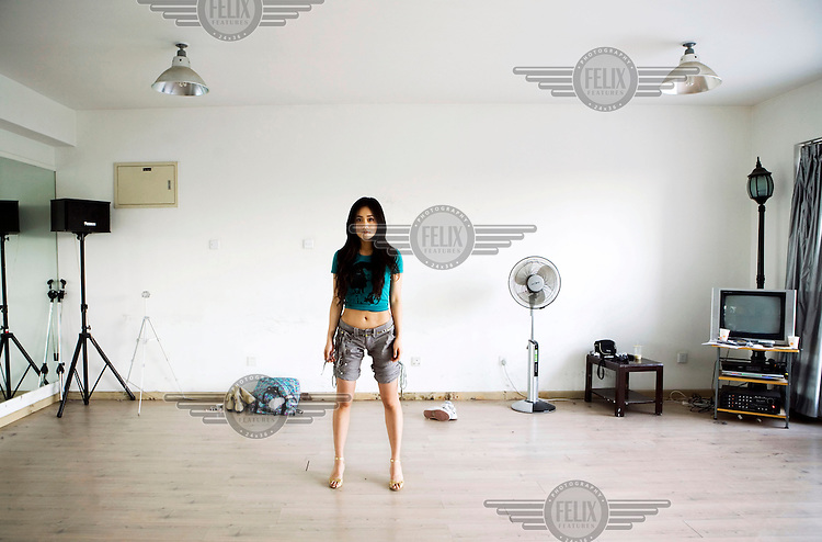 Liu Yun, a 23 year old actress in a dance studio in Beijing.