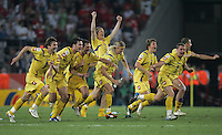 The Ukrainian team celebrates immediately after the last penalty kick.  Ukraine defeated Switzerland on penalty kicks in their FIFA World Cup round of 16 match at FIFA World Cup Stadium in Cologne, Germany, June 26, 2006.