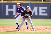 Richard Carter (10) of the Coastal Carolina Chanticleers takes his lead off of second base against the High Point Panthers at Willard Stadium on March 15, 2014 in High Point, North Carolina.  The Chanticleers defeated the Panthers 1-0 in the first game of a double-header.  (Brian Westerholt/Four Seam Images)