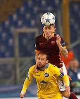 Calcio, Champions League: Gruppo E - Roma vs Bate Borisov. Roma, stadio Olimpico, 9 dicembre 2015.<br /> Roma's Lucas Digne, top, jumps over Bate Borisov's Igor Stasevich to head the ball during the Champions League Group E football match between Roma and Bate Borisov at Rome's Olympic stadium, 9 December 2015.<br /> UPDATE IMAGES PRESS/Riccardo De Luca