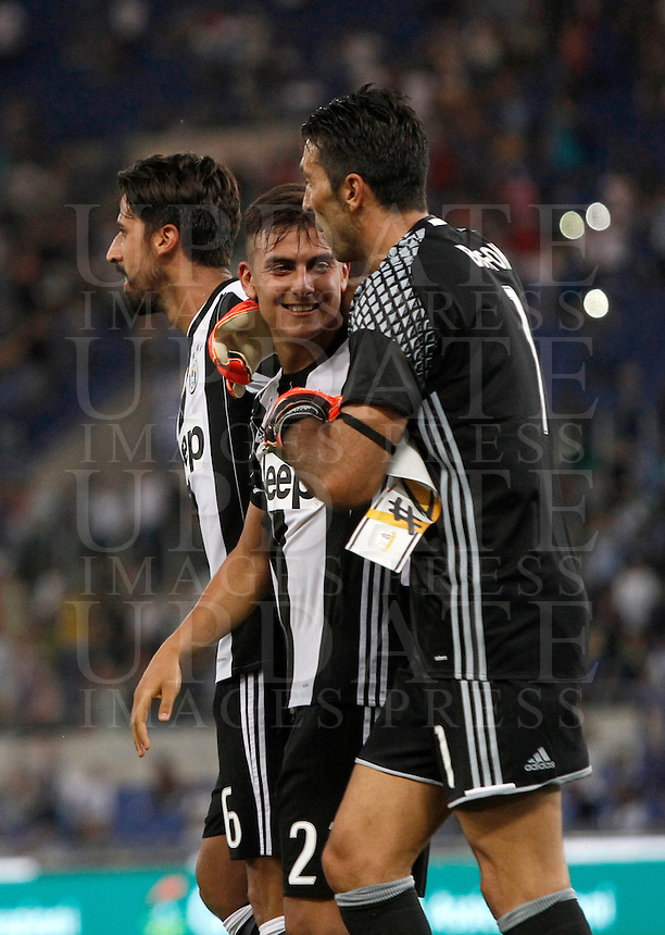 Calcio, Serie A: Lazio vs Juventus. Roma, stadio Olimpico, 27 agosto 2016.<br /> From left, Juventus' Sami Khedira, Paulo Dybala and Gianluigi Buffon celebrate at the end of the Serie A soccer match between Lazio and Juventus, at Rome's Olympic stadium, 27 August 2016. Juventus won 1-0.<br /> UPDATE IMAGES PRESS/Isabella Bonotto