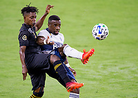 LOS ANGELES, CA - SEPTEMBER 23: Latif Blessing #7 of LAFC and Cristian Dajome #11 of the Vancouver Whitecaps battle for a ball during a game between Vancouver Whitecaps and Los Angeles FC at Banc of California Stadium on September 23, 2020 in Los Angeles, California.