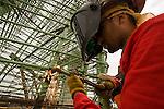 A construction worker welds on a rebar cage at Trimet's Portland-Milwaukie Light Rail Bridge project.