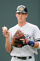 Catcher Peter O'Brien (9) of the Charleston RiverDogs before a game against the Greenville Drive on Wednesday, June 12, 2013, at Fluor Field at the West End in Greenville, South Carolina. Charleston won, 10-5. The teams wore their Boston and New York affiliate uniforms as part of a promotion. (Tom Priddy/Four Seam Images)
