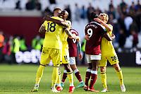 3rd October 2021;   City of London Stadium, London, England; EPL Premier League football, West Ham versus Brentford; Yoane Wissa of Brentford celebrates the 1-2 win with Pontus Jansson
