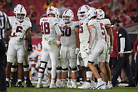 LOS ANGELES, CA - SEPTEMBER 11: Tanner McKee #18 of the Stanford Cardinal huddles with the offense during a game between University of Southern California and Stanford Football at Los Angeles Memorial Coliseum on September 11, 2021 in Los Angeles, California.