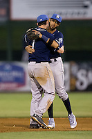 Asheville Tourists shortstop Brendan Rodgers (1) gets a hug from second baseman Carlos Herrera (4) following their win over the Kannapolis Intimidators at Kannapolis Intimidators Stadium on May 26, 2016 in Kannapolis, North Carolina.  The Tourists defeated the Intimidators 9-6 in 11 innings.  (Brian Westerholt/Four Seam Images)