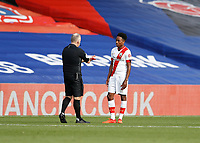 12th September 2020; Selhurst Park, London, England; English Premier League Football, Crystal Palace versus Southampton; Referee John Moss retracts his decision to give a straight red card to Kyle Walker-Peters of Southampton for a tackle on Tyrick Mitchell of Crystal Palace  but VAR rescinded to yellow