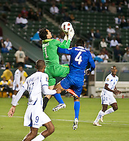 CARSON, CA – June 6, 2011: Guatemala goalie Ricardo Jerez (1) goes up to catch a shot on goal with teammate Carlos Mauricio Castrillo (4) during the match between Guatemala and Honduras at the Home Depot Center in Carson, California. Final score Guatemala 0, Honduras 0.