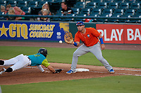 St. Lucie Mets first baseman Jeremy Vasquez (16) stretches for a throw as Travis Swaggerty (12) dives back to the bag during a Florida State League game against the Bradenton Barbanegras on July 27, 2019 at LECOM Park in Bradenton, Florida.  Bradenton defeated St. Lucie 3-2.  (Mike Janes/Four Seam Images)
