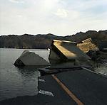 On March 11, 2011, earthquake of magnitude 9.0 and devastating tsunami hit the Tohoku area, killing more than 15,000 people and missing more than 5,000 people.<br /> Destroyed road and waterbreaks at Unosumai district in Kamaishi, Iwate.<br /> <br /> Le 11 mars 2011, un séisme de magnitude 9,0 et un tsunami dévastateur ont frappé la région de Tohoku, faisant plus de 15 000 morts et plus de 5 000 disparus.<br /> Route détruite et digues d'eau dans le district d'Unosumai à Kamaishi, Iwate.