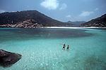 Thailand, Couple swimming off Ko Nang Yuan resort, Ko Tao, Gulf of Thailand, Southwest Asia,.