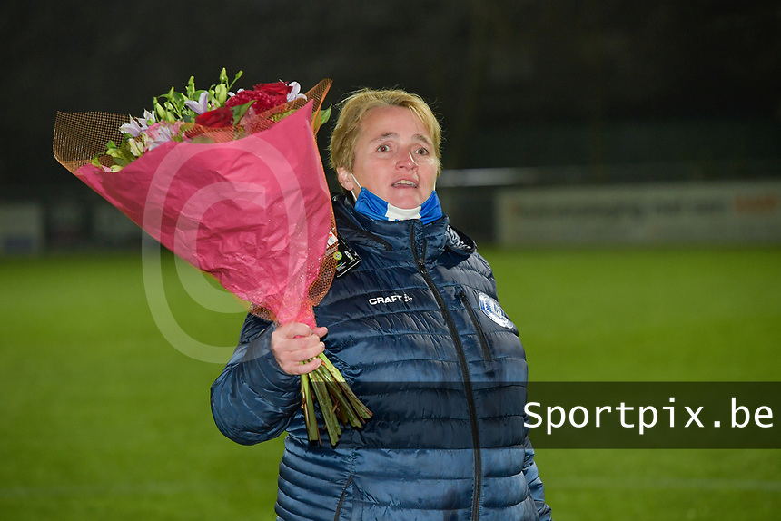 Gent's Dominique Reyns with flowers to celebrate Heleen Jaques for her Red Flames caps pictured during a female soccer game between  AA Gent Ladies and Oud Heverlee Leuven on the 9th matchday of the 2020 - 2021 season of Belgian Scooore Womens Super League , friday 11 th of December 2020  in Oostakker , Belgium . PHOTO SPORTPIX.BE | SPP | DIRK VUYLSTEKE