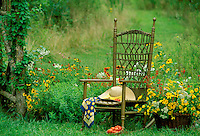 Summer garden with rocking chair and quiet place to eat tomatoes, Midwest USA