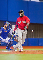 1 April 2016: Boston Red Sox designated hitter David Ortiz is hit by a foul during a pre-season exhibition series between the Toronto Blue Jays and the Boston Red Sox at Olympic Stadium in Montreal, Quebec, Canada. The Red Sox defeated the Blue Jays 4-2 in the first of two MLB weekend games, which saw an attendance of 52,682 at the former home on the Montreal Expos. Mandatory Credit: Ed Wolfstein Photo *** RAW (NEF) Image File Available ***
