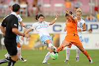 Karen Carney (14) of the Chicago Red Stars and Kendall Fletcher (5) of Sky Blue FC go for the ball. The Chicago Red Stars defeated Sky Blue FC 2-1 during a Women's Professional Soccer (WPS) match at Yurcak Field in Piscataway, NJ, on August 01, 2010.