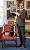 BNPS.co.uk (01202 558833)<br /> Pic: ZacharyCulpin/ BNPS<br /> <br /> Pictured: Auctioneer, Clifford Lansberry of Gorringe's holding the painting as the resident Gorringe's dog looks on.<br /> <br /> A 'lost' painting by the Italian master Canaletto that was found hanging in the drawing room of an English home after 100 years sold for over £380,000.<br /> <br /> The 18ins by 12ins oil on canvas work was bought in London in 1920 for about £100 - £5,000 in today's money - by the mother of the late owner who died recently.<br /> <br /> She inherited it over 50 years ago and hung it on the wall of the detached house in Lewes, East Sussex, that she moved into in 1970.