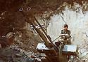 Lebanon 1980 .Azad Sagerma and an anti-aircraft gun.<br /> Liban 1980.Dans un camp d'entrainement, Azad Sagerma posant a cote d'une DCA