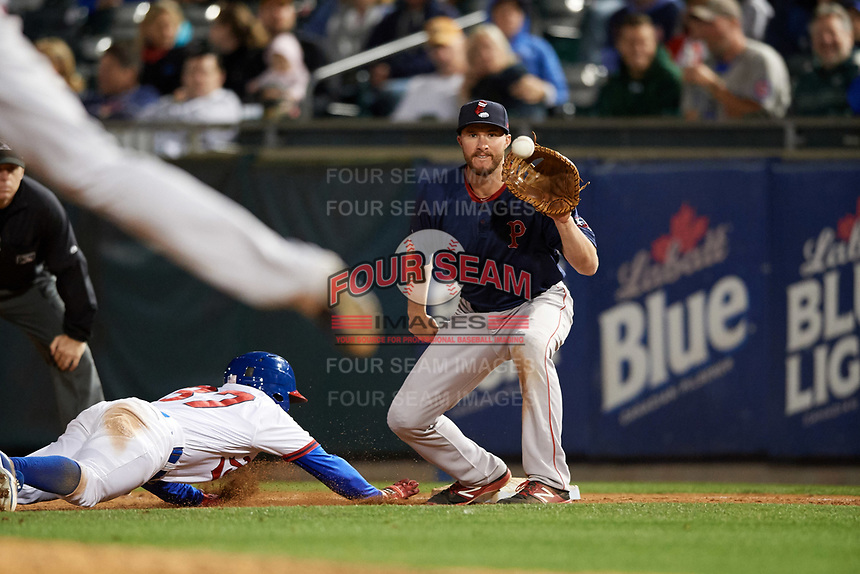 Pawtucket Red Sox first baseman Jantzen Witte (31) waits for a pickoff attempt throw as Roemon Fields (37) dives back to the bag during a game against the Buffalo Bisons on August 31, 2017 at Coca-Cola Field in Buffalo, New York.  Buffalo defeated Pawtucket 4-2.  (Mike Janes/Four Seam Images)