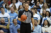 CHAPEL HILL, NC - FEBRUARY 1: Official Matt Potter holds the ball during a game between Boston College and North Carolina at Dean E. Smith Center on February 1, 2020 in Chapel Hill, North Carolina.