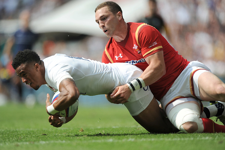 Anthony Watson of England forces his way past George North of Wales to score a try during the Old Mutual Wealth Cup match between England and Wales at Twickenham Stadium on Sunday 29th May 2016 (Photo: Rob Munro/Stewart Communications)