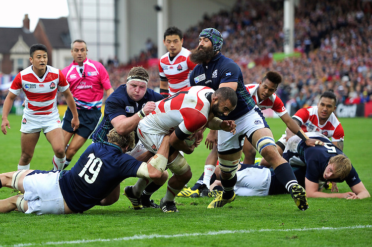 Michael Leitch of Japan attempts to reach the try-line. Rugby World Cup Pool B match between Scotland and Japan on September 23, 2015 at Kingsholm Stadium in Gloucester, England. Photo by: Patrick Khachfe / Stewart Communications