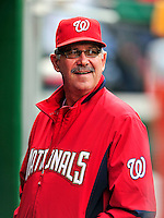 30 September 2009: Syracuse Chiefs' Manager Tim Foli, called up to the Washington Nationals for September, smiles in the dugout prior to a game against the New York Mets at Nationals Park in Washington, DC. The Nationals rallied in the bottom of the 9th inning with a Justin Maxwell walk-off Grand Slam to win 7-4 and sweep the Mets to cap the final game of the Nationals' home season. Mandatory Credit: Ed Wolfstein Photo