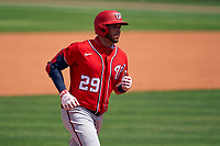Washington Nationals Yadiel Hernandez (29) rounds the bases after hitting a home run during a Major League Spring Training game against the New York Mets on March 18, 2021 at Clover Park in St. Lucie, Florida.  (Mike Janes/Four Seam Images)