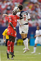 Panama's Jose Anthony Torres and USA's Clint Dempsey go up for a header. The United States defeated Panama 3-1 in a shoot out after a scoreless game to win the CONCACAF Gold Cup at Giant's Stadium, East Rutherford, NJ, on July 24, 2005.