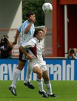 Sebasti‡n Bataglia, left, Ben Olsen, right, Argentina vs. USA, Miami, Fla.