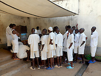 Death Row inmates watching television at Luzira Upper Prison, Uganda's largest maximum security prison. It was built in the 1920s to accommodate 600 prisoners. On the 3 April 2015 it housed 3,114, of whom 1,350 were on remand and 1,376 were convicts, plus 388 on Death Row.