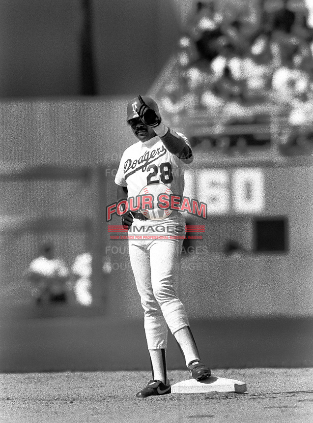 Los Angeles Dodgers Pedro Guerrero #28 during a game against the New York Mets at Dodger Stadium during the 1987 season in Los Angeles,California.(Larry Goren/Four Seam Images)
