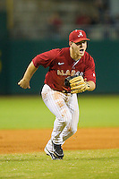 Third baseman Brett Booth #5 of the Alabama Crimson Tide charges towards home plate against the Auburn Tigers at Riverwalk Park on March 15, 2011 in Montgomery, Alabama.  Photo by Brian Westerholt / Four Seam Images