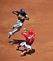 23 August 2009: Milwaukee Brewers' shortstop Alcides Escobar is unable to make the play at second against a sliding Nyjer Morgan of the Washington Nationals at Nationals Park in Washington, DC. The Nationals defeated the Brewers 8-3 to take the third game of their four-game series, snapping a five games losing streak. Mandatory Credit: Ed Wolfstein Photo