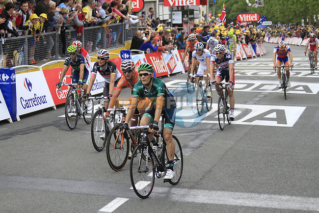 The main bunch including Pierre Rolland (FRA) Europcar Team crosses the finish line at the end of Stage 3 of the 99th edition of the Tour de France 2012, running 197km from Orchies to Boulogne-sur-Mere, France. 3rd July 2012.<br /> (Photo by Eoin Clarke/NEWSFILE)